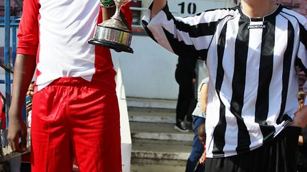 The captains of Holloway School (left) and Haverstock School share the Islington Gazette Schools Cup