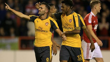 Arsenal's Lucas Perez (left) celebrates scoring his side's third goal of the game at Nottingham Fore
