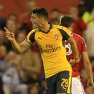 Arsenal's Granit Xhaka (right) celebrates scoring his side's first goal of the game at Nottingham Fo