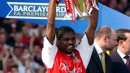 Kanu - who netted a treble on Saturday - pictured with the 2002 Premier League trophy.