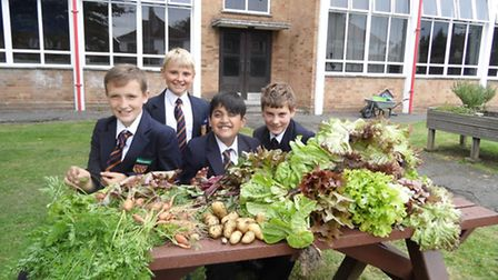 Pupils from St Gregory's Catholic Science College with harvest from their Eco Garden