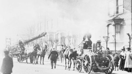Crews using a horse-drawn cart deal with a fire at 128, Tufnell Park Road in 1907. Picture: London F