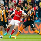 Arsenal's Francis Coquelin and Hull City's Tom Huddlestone battle for the ball during the Premier Le