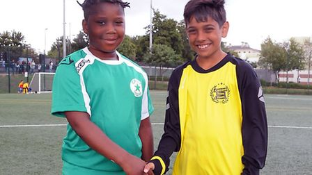 U11 captains Josh Usuku of Cally Stars (left) and Daniel Gardner of Camden Town Youth before the sta