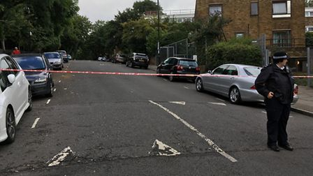A police officer in Sunnyside Road, Hornsey Rise, after the shooting. Picture: James Morris
