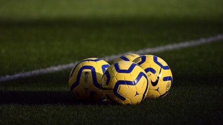 Match balls on the pitch prior to the start of a match. Picture Joe Giddens/PA Images