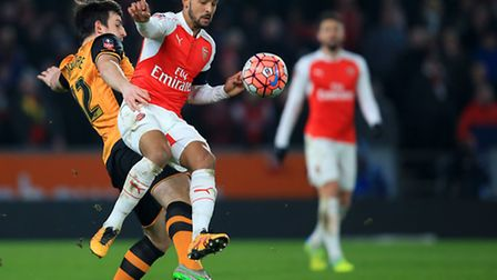 Hull City's Harry Maguire (left) and Arsenal's Theo Walcott battle for the ball during the sides' FA