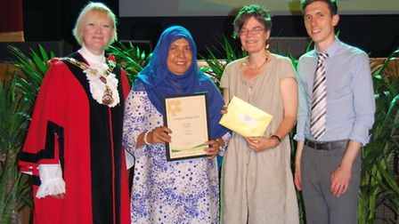 Prah Road was named 'best street', sponsored by the Gazette. Residents are presented with the award