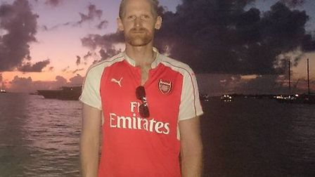Arsenal fan Gareth Bannister flies the flag for the Gunners in the Maldives