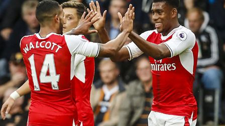 Arsenal's Alex Iwobi (right) celebrates with team-mate Theo Walcott after his assist for Alexis Sanc
