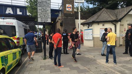 Emergency services and displaced commuters outside Caledonian Road and Barnsbury station (Picture: S