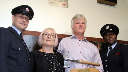 John Carpenter, left, and staff officer Karen Bell, right, with the brother (Maurice) and sister (Ma