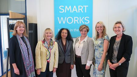 MP Emily Thornberry (third right) with CEO Kate Stephens (second right), volunteers and a client (mi