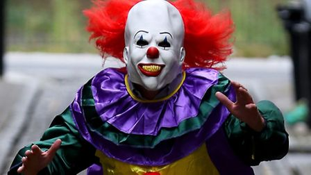 A file image of a 'killer clown', posed by a model. A woman was chased down the road by a knife-wiel