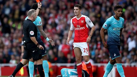 Arsenal's Granit Xhaka is sent-off by match referee Jon Moss during the Premier League match at the