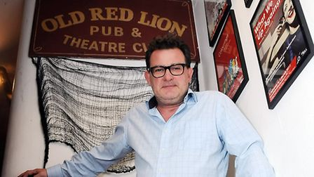 Damien Devine with artefacts from the Old Red Lion Theatre Pub's 600-year history. Picture: Dieter P