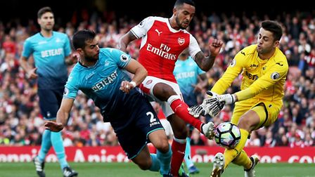 Theo Walcott scores his first goal in Arsenal's 3-2 win over Swansea