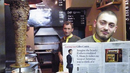 Michael Ustun of the Kentish Town branch of E.Mono holds up a copy of Giles Coren's rave review
