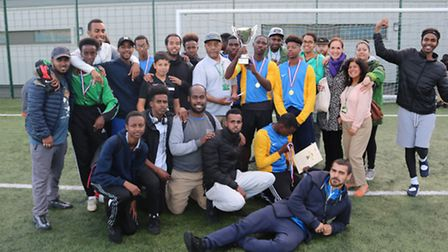 Muslim Welfare House, the winning team at Sunday's Peace Cup, with the organisers of the tournament