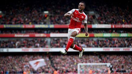 Arsenal's Theo Walcott celebrates scoring his side's second goal of the game during the Premier Leag