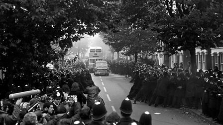 PA NEWS PHOTO 17/10/77 POLICE STRUGGLE TO HOLD BACK HUNDREDS OF PICKETS AS A WORKER'S BUS APPROACHE