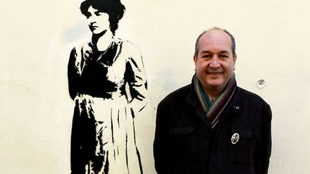 Tour guide Rob Smith with a Mary Wollstonecraft mural at Newington Green Unitarian Church. Picture:
