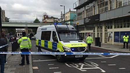 Police in Holloway Road, near its junction with Hornsey Road, this afternoon. Picture: James Morris