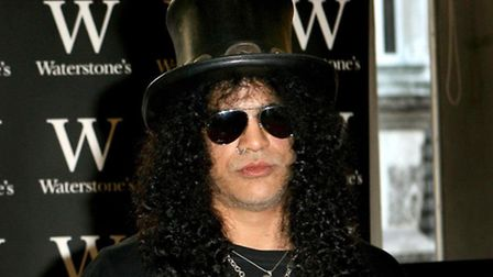 Slash - pictured at a book signing in central London in 2007 - was once a customer at Highbury Jean