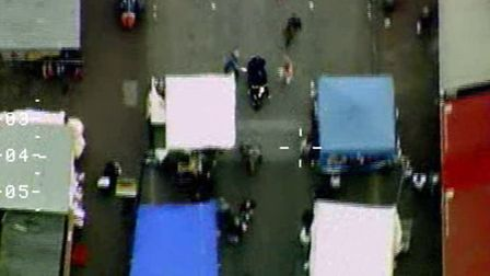 The moped can be seen racing through Ridley Road market minutes before Hutson was caught