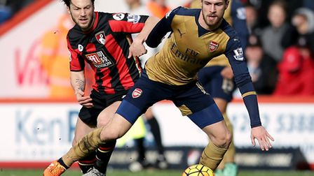 Arsenal's Aaron Ramsey (right) and AFC Bournemouth's Harry Arter battle for the ball during the side