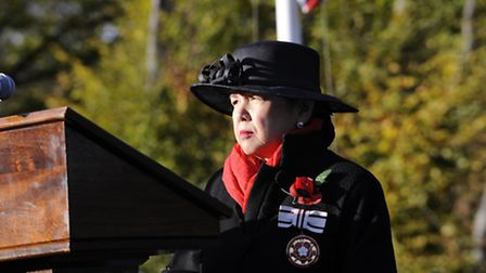 Mei Sim Lai OBE reads at the Remembrance Service in Barham Park