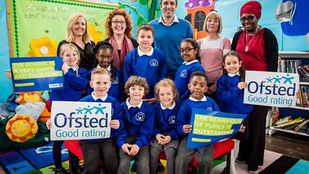 The Moreland Primary School leadership team and pupils celebrate the school's first 'good' Ofsted ra