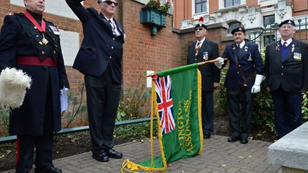 Islington Veterans Association lower the flag as the Last Post is played at the Manor Gardens unveil