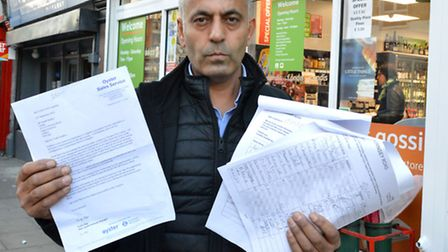 Turabi Keskin outside his Londis shop in Hornsey Road with some of the 400 signatures in favour of g