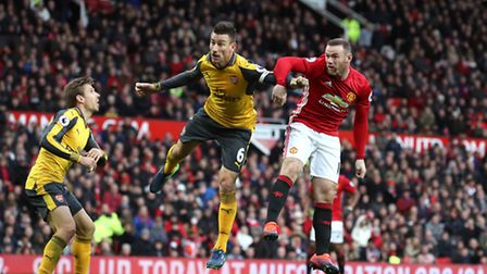 Manchester United's Wayne Rooney (right) and Arsenal's Laurent Koscielny compete for the ball in Sat