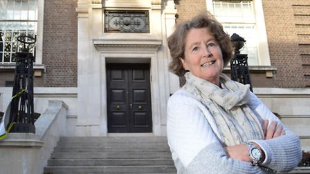 Historian Oonagh Gay stands outside the original main entrance to Islington Town Hall, facing Richmo