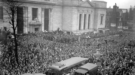Thousands of Arsenal fans pack the streets outside Islington Town Hall to greet the 1930 FA Cup winn