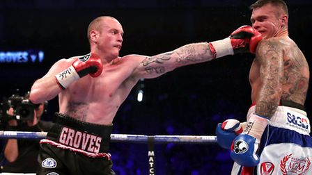 George Groves (left) in action against Martin Murray during their WBA International Super-Middleweig