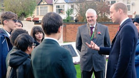The Duke of Cambridge with Newman Catholic College students at a ceremony in Willesden New Cemetery