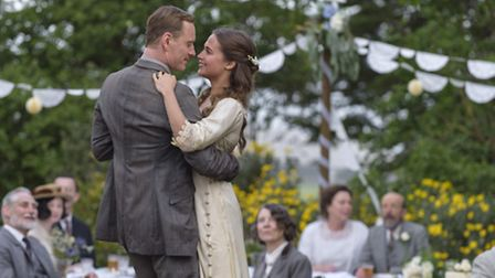 Michael Fassbender stars as Tom Sherbourne and Alicia Vikander as his wife Isabel in DreamWorks Pict