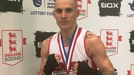 Islington BC's Jerome Campbell with his silver medal at the England Boxing Development Championships
