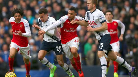 Arsenal's Francis Coquelin and Tottenham Hotspur's Eric Dier battle for the ball during the sides' l