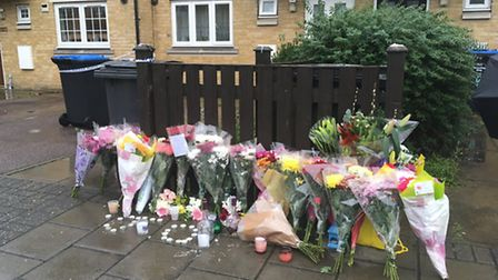 Flowers and candles left at the scene where James Owusu-Agyekum was killed (Pic: Nathalie Raffray)