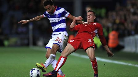 Bristol City's Joe Bryan, (left) battles for the ball with Queens Park Rangers' James Perch, (right)