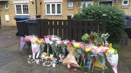 Flowers and candles left for James Owusu, gunned down outside his home on Tynesdale Road (Pic: Nath