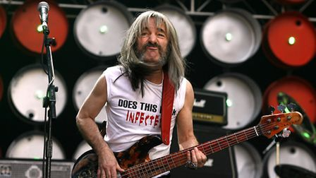 Harry Shearer, as Spinal Tap's Derek Smalls, performs during the charity concert at Wembley Stadium,