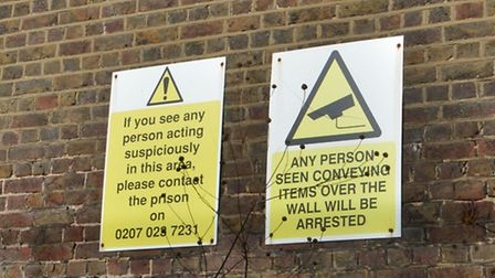 Signs on Pentonville's walls warn people will be prosecuted if they throw items into the prison. Pic