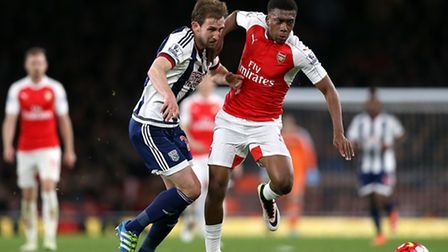 Arsenal's Alex Iwobi (right) and West Bromwich Albion's Craig Dawson battle for the ball during the