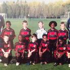Tafari Moore (back row, third right) and Osman Kakay (front row, second left) - pictured here in an