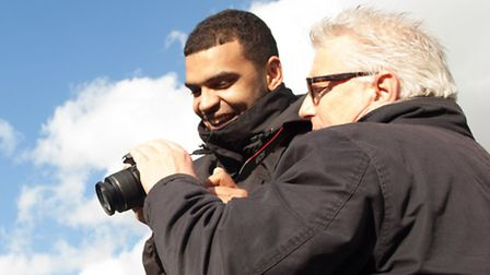 Joshua Campbell with club photographer Stuart McFarlane on an Arsenal in the Community course. Pictu